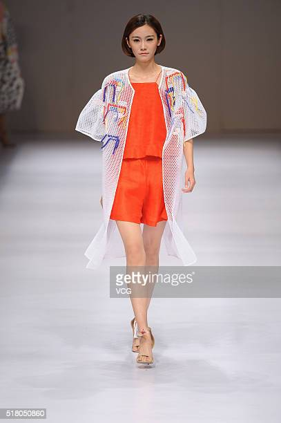 A model showcases designs on the runway at Beijing Institute of Fashion Technology¡¤Emerging Design Collection 'BIFT¡¤ELLASSAY' Scholarship Awarding...