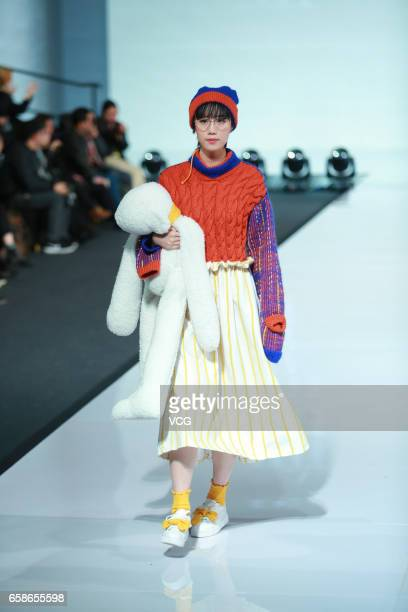 A model showcases designs on the runway at BIFTMMUSCU collection during MercedesBenz China Fashion Week Autumn/Winter 2017/2018 at Beijing Hotel on...