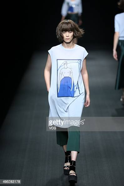 A model showcases designs on the runway at broadcastbo Wang Tao Collection during the MercedesBenz China Fashion Week S/S 2016 Collection at Beijing...