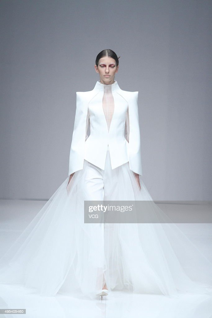A model showcases designs on the runway at China Buyer AlexanderTZhao Zhao Tao/ XLANDO Meng Yang Collection during the MercedesBenz China Fashion...