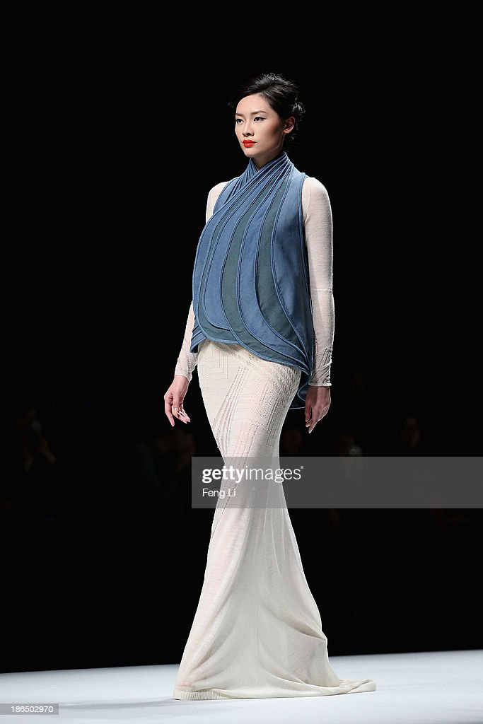 A model showcases designs on the runway at CHUHETINGXIANG Chu Yan Collection show during Mercedes-Benz China Fashion Week Spring/Summer 2014 at Beijing Hotel on October 31, 2013 in Beijing, China.