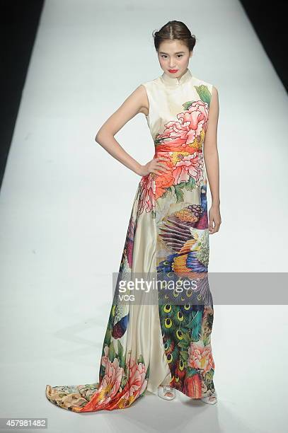 A model showcases designs on the runway at COSMOBride CHOW TAI FOOK Bridal Wear Trends Launch show during the third day of the MercedesBenz China...
