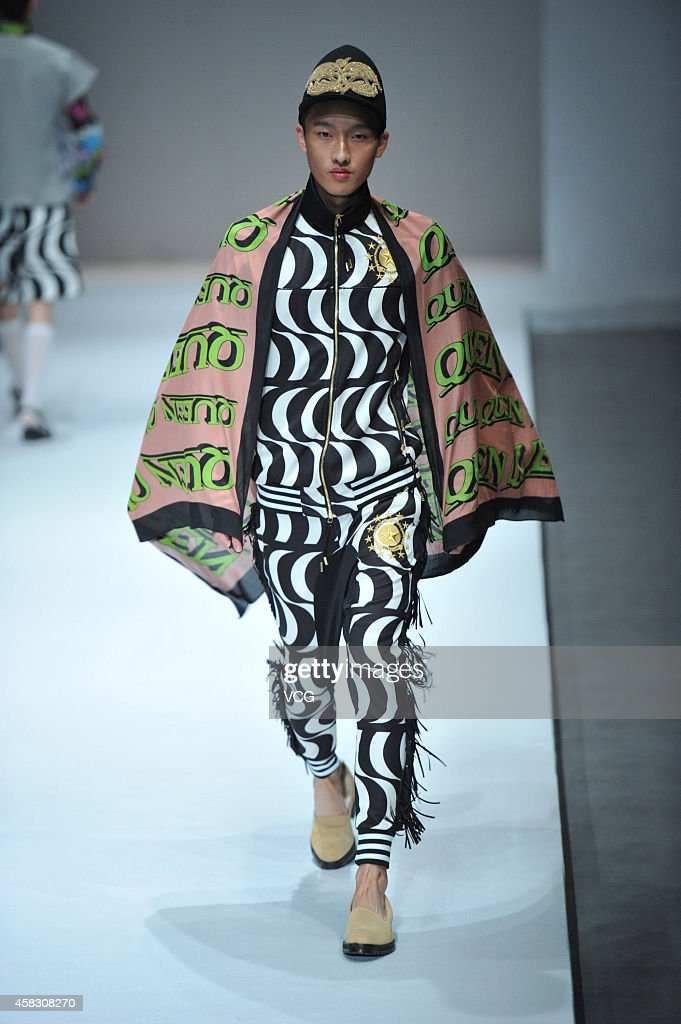 A model showcases designs on the runway at DRESSCAMP Toshikazu Iwaya Collection show during the MercedesBenz China Fashion Week Spring/Summer 2015 at...