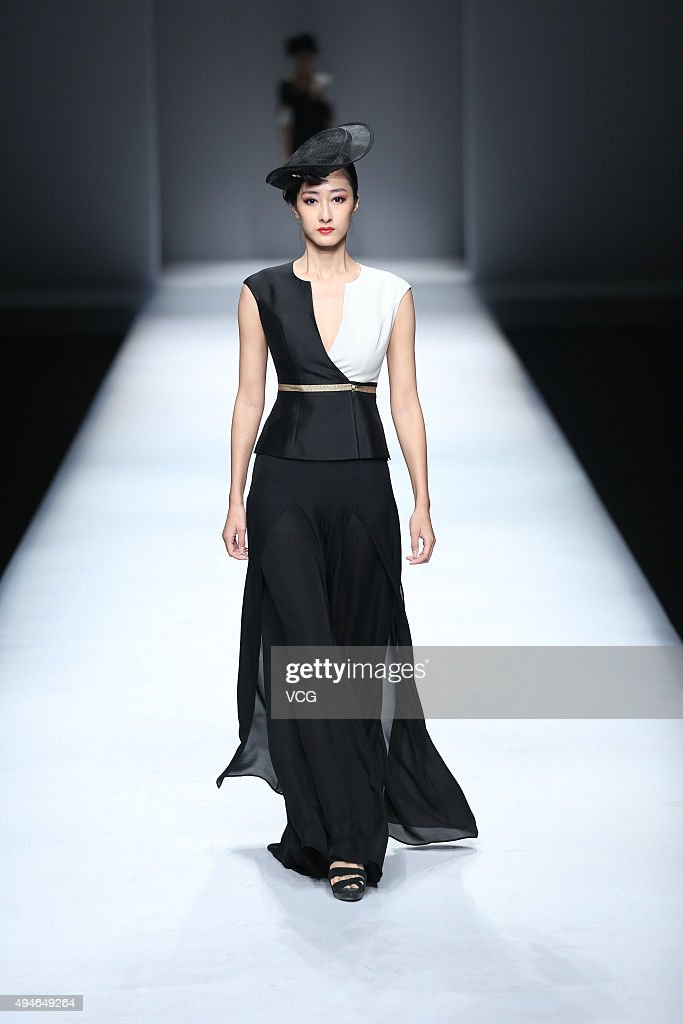 A model showcases designs on the runway at FADVSUN Sun Juxiang Collection during the MercedesBenz China Fashion Week Spring/Summer 2016 at Beijing...