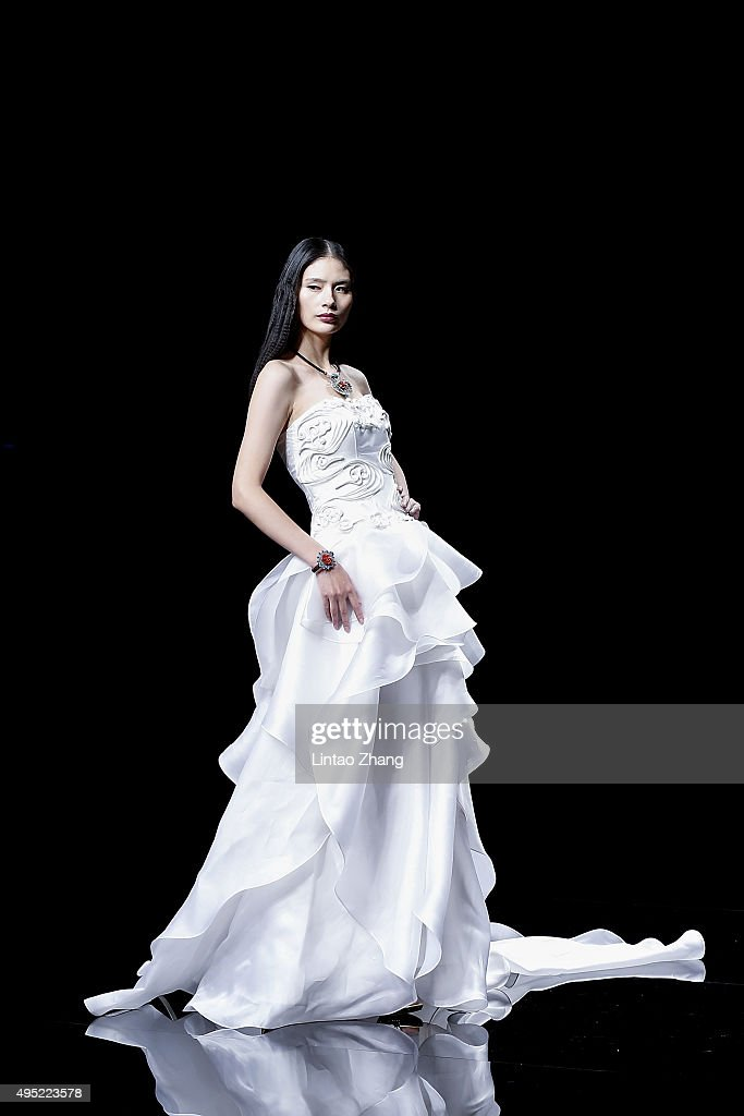 A model showcases designs on the runway at Fei Gallery Boutique Sun Xuefei Collection show during the MercedesBenz China Fashion Week Spring/Summer...
