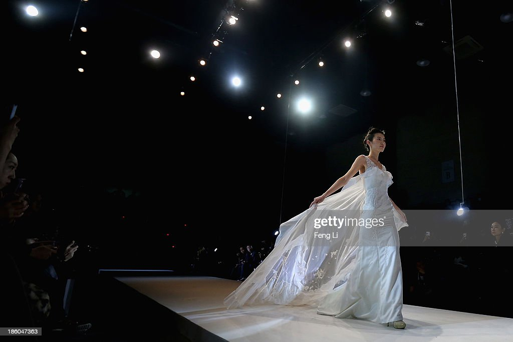 A model showcases designs on the runway at GALATEA Wedding Dress Collection show during Mercedes-Benz China Fashion Week Spring/Summer 2014 at Beijing Hotel on October 27, 2013 in Beijing, China.