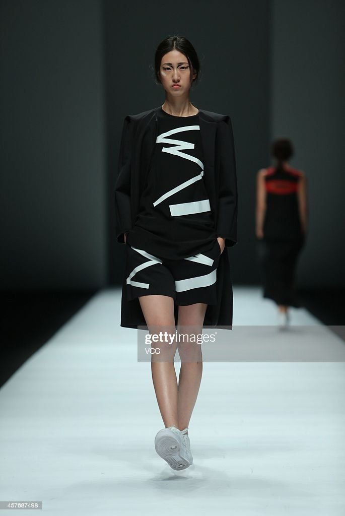 A model showcases designs on the runway at Haizhen Wang show during the Shanghai Fashion Week 2015 Spring/Summer on October 22 2014 in Shanghai China