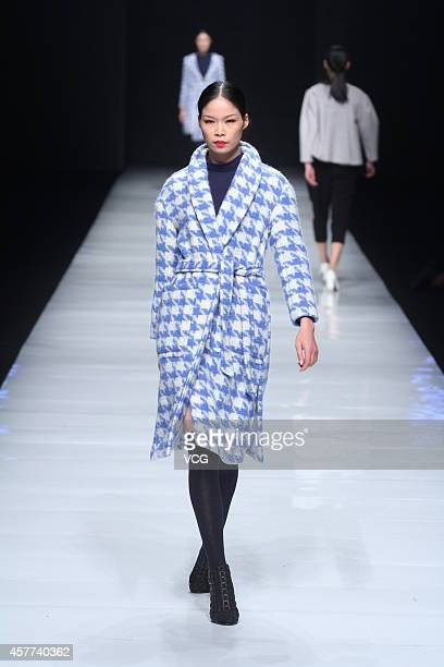 A model showcases designs on the runway at He Jiani's show during 2014 Ningbo Fashion Week on October 23 2014 in Ningbo Zhejiang province of China