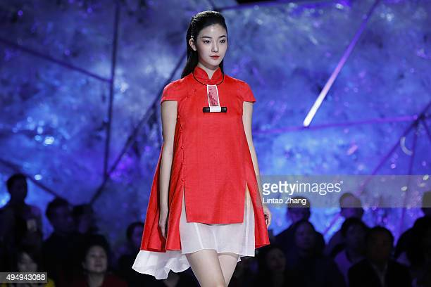 A model showcases designs on the runway at Heaven Gaia Xiong Ying High Fashion Collection show during the MercedesBenz China Fashion Week...