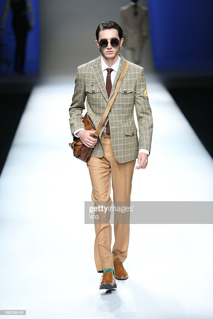 A model showcases designs on the runway at HENRY HERBERT Liu Yong Private Custom Collection during the MercedesBenz China Fashion Week S/S 2016...