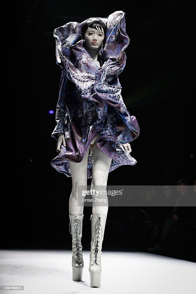 A model showcases designs on the runway at HEYUANCIYE Hu Sheguang Collection show during day seven of MercedesBenz China Fashion Week Spring/Summer...