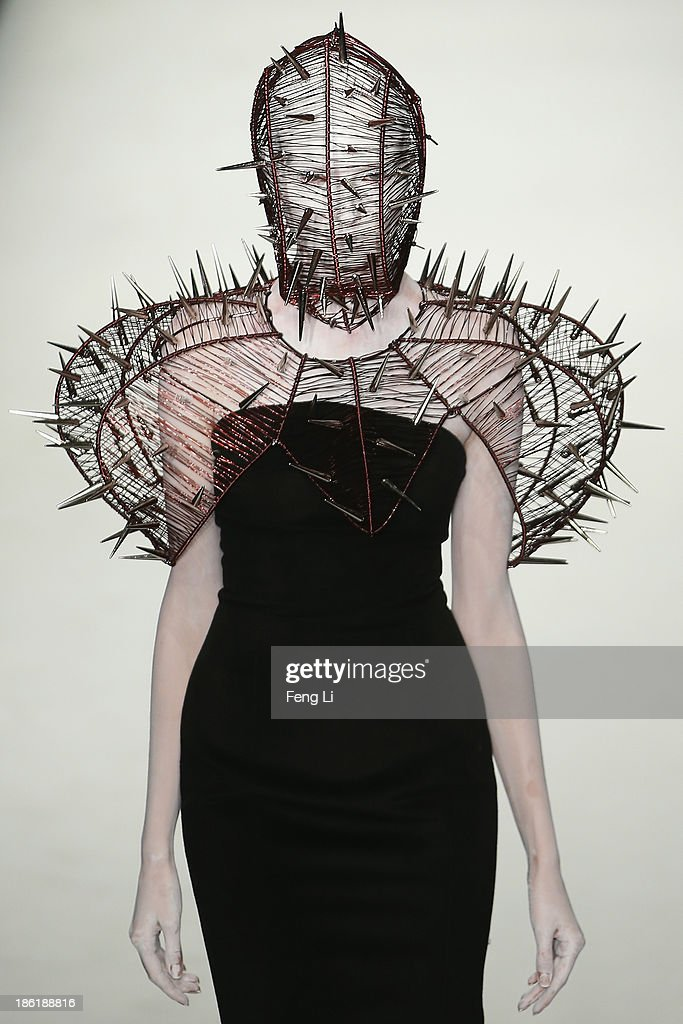 A model showcases designs on the runway at Hu Sheguang Haute Couture Collection show during Mercedes-Benz China Fashion Week Spring/Summer 2014 at 751 D-PARK Workshop on October 29, 2013 in Beijing, China.