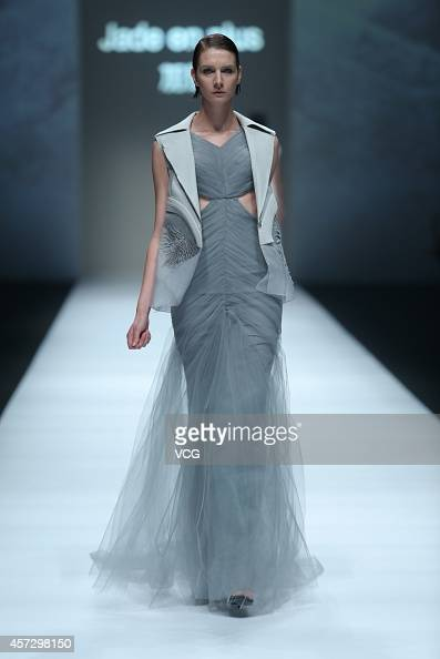 A model showcases designs on the runway at Jade en Plus collection show during the second day of the Shanghai Fashion Week 2015 Spring/Summer at...