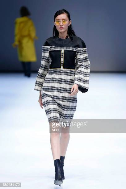 A model showcases designs on the runway at JD UYEN collection by designer Han Dongyang during MercedesBenz China Fashion Week Autumn/Winter 2017/2018...