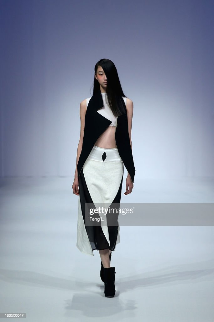 A model showcases designs on the runway at JUST FOR TEE Zhang Beiyong Collection show during Mercedes-Benz China Fashion Week Spring/Summer 2014 at 751 D-PARK Central Hall on October 31, 2013 in Beijing, China.