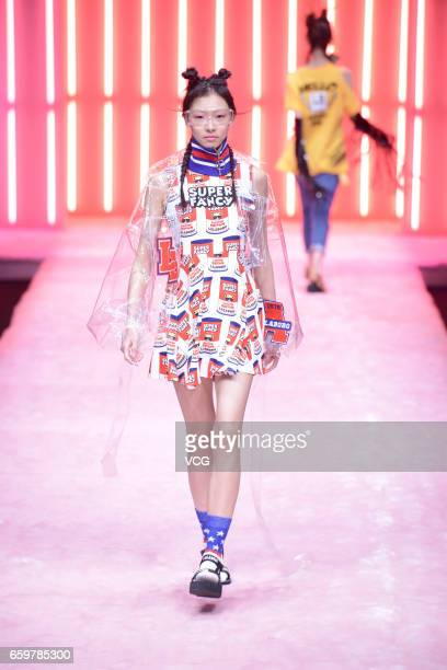 A model showcases designs on the runway at LALABOBO collection by designer Yu Xizi during MercedesBenz China Fashion Week Autumn/Winter 2017/2018 at...