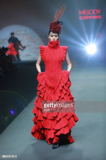 A model showcases designs on the runway at MELODY Cashmere Carey Xu collection during MercedesBenz China Fashion Week Autumn/Winter 2017/2018 at...