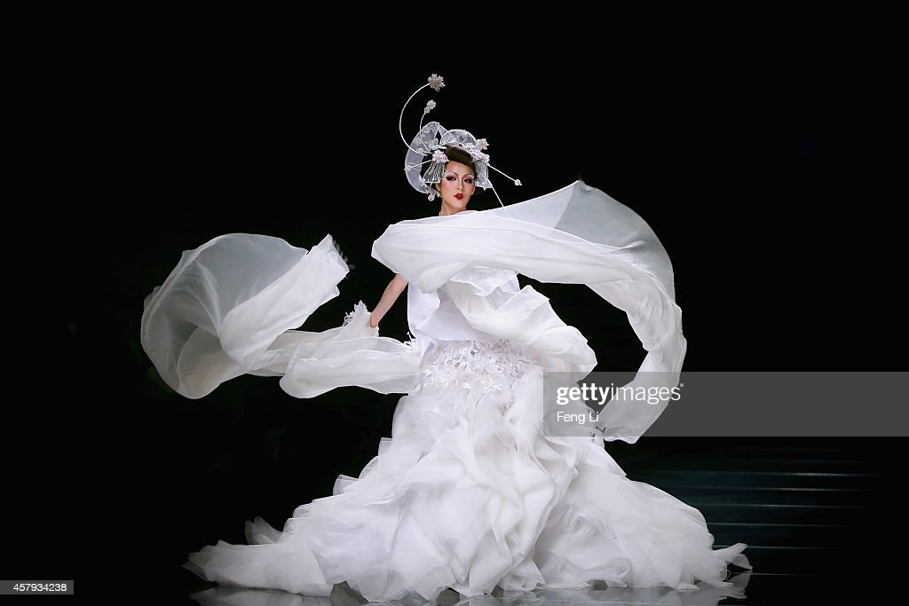 A model showcases designs on the runway at MGPIN 2015 Mao Geping Makeup Trends Launch show during MercedesBenz China Fashion Week Spring/Summer 2015...