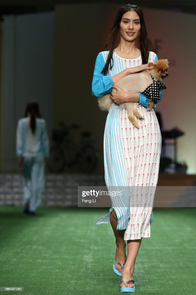 A model showcases designs on the runway at LA NOUVELLE FAMILLE Ma Bin Home Wear Collection show during Mercedes-Benz China Fashion Week Spring/Summer 2014 at 751 D-PARK Workshop on October 31, 2013 in Beijing, China.