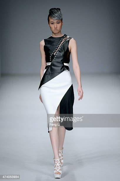 A model showcases designs on the runway at School of Fashion Dalian Polytechnic University Graduates Show during the day six of China Graduate...