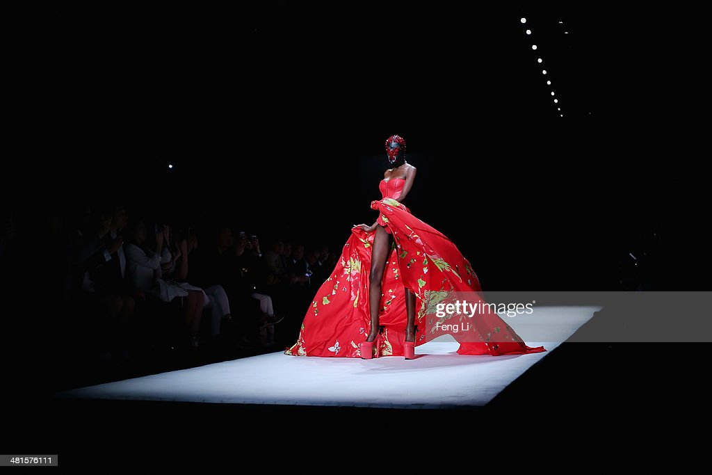A model showcases designs on the runway at SECCRY Hu Sheguang Collection 2014 Show during Mercedes-Benz China Fashion Week Autumn/Winter 2014/2015 at the Banquet Hall of Beijing Hotel on March 30, 2014 in Beijing, China.