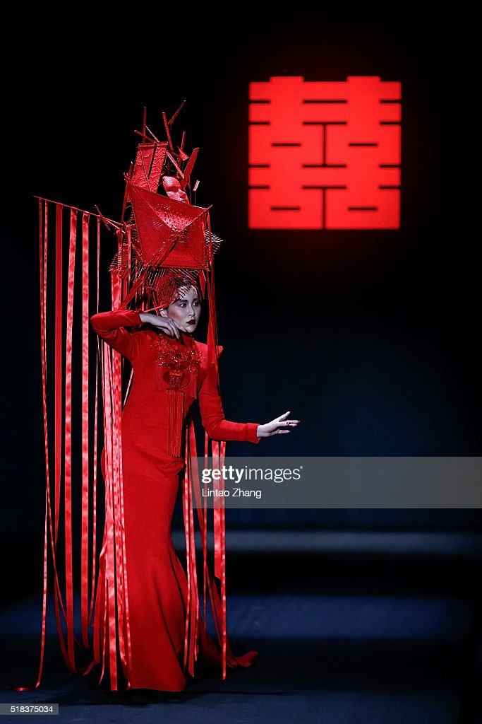 A model showcases designs on the runway at Sheguang Hu Collection during the MercedesBenz China Fashion Week Autumn/Winter 2016/2017 at 751DPark on...