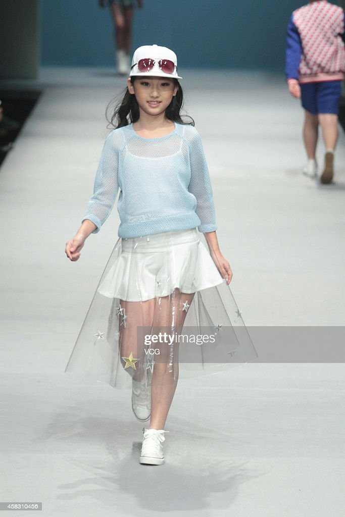 A model showcases designs on the runway at Showkids 'Liu Jia Children' Collection show during the MercedesBenz China Fashion Week Spring/Summer 2015...