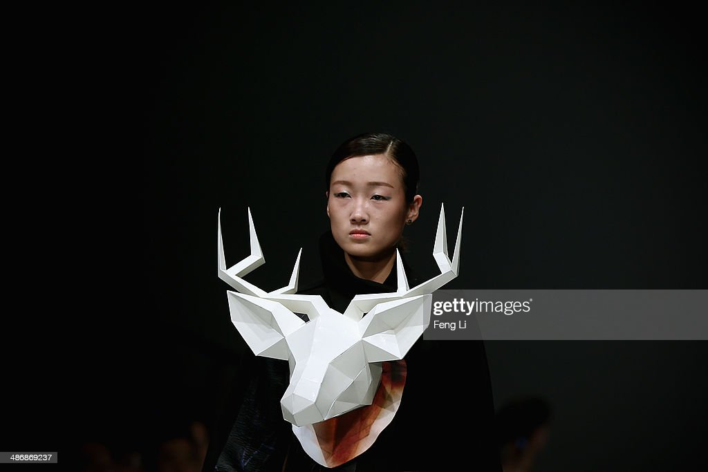 A model showcases designs on the runway at Sichuan Fine Arts Institute Graduates Show during the 2014 China Graduate Fashion Week at the 751D.Park Central Hall on April 26, 2014 in Beijing, China.