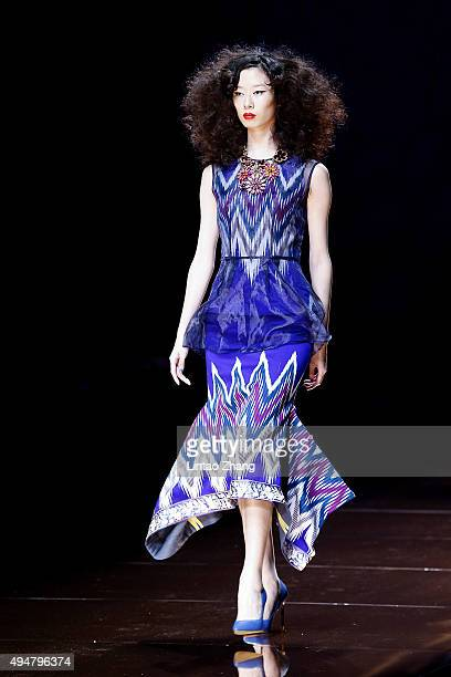 A model showcases designs on the runway at Silk Road Star Cheng Yingfen Collection show during the MercedesBenz China Fashion Week Spring/Summer 2016...