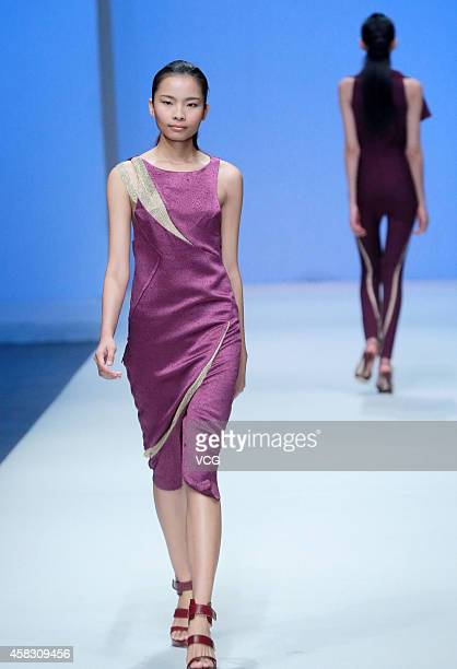 A model showcases designs on the runway at SON JUNG WAN Collection show during the MercedesBenz China Fashion Week Spring/Summer 2015 at Central Hall...