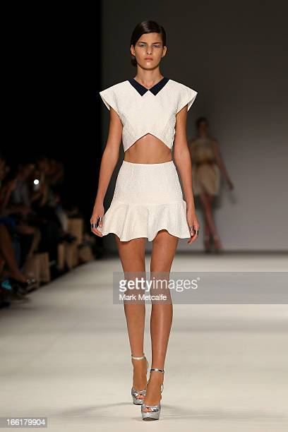 A model showcases designs on the runway at the Alice McCall show during MercedesBenz Fashion Week Australia Spring/Summer 2013/14 at Carriageworks on...