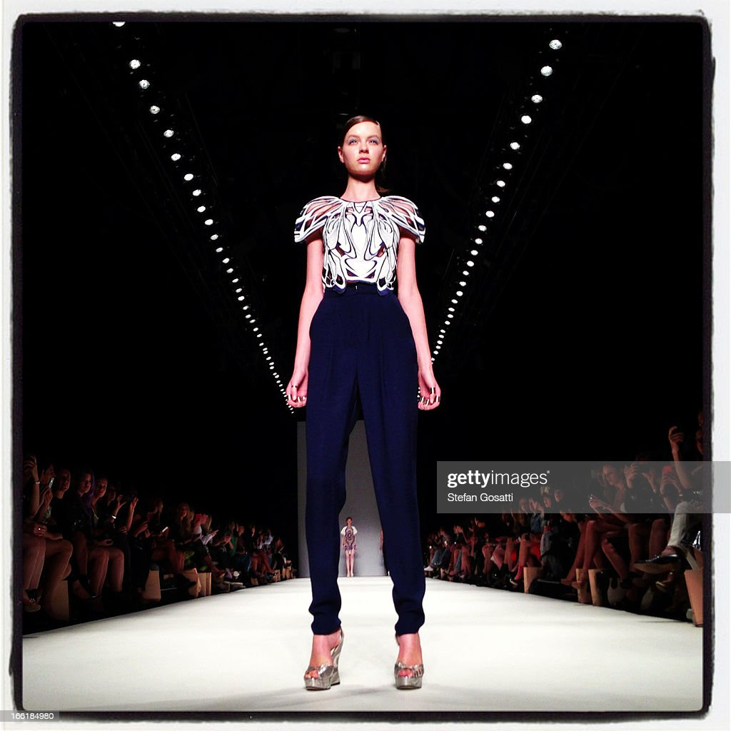 A model showcases designs on the runway at the Alice McCall show during Mercedes-Benz Fashion Week Australia Spring/Summer 2013/14 at Carriageworksat Carriageworks on April 10, 2013 in Sydney, Australia.