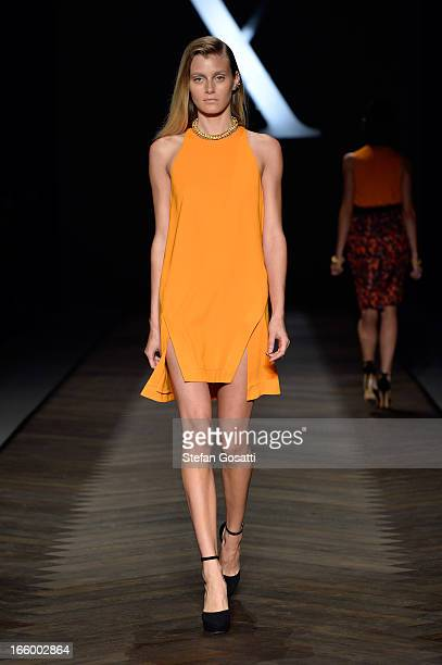 A model showcases designs on the runway at the Camilla and Marc show during MercedesBenz Fashion Week Australia Spring/Summer 2013/14 at...