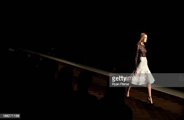 A model showcases designs on the runway at the Camilla and Mark show during MercedesBenz Fashion Week Australia Spring/Summer 2013/14 at...