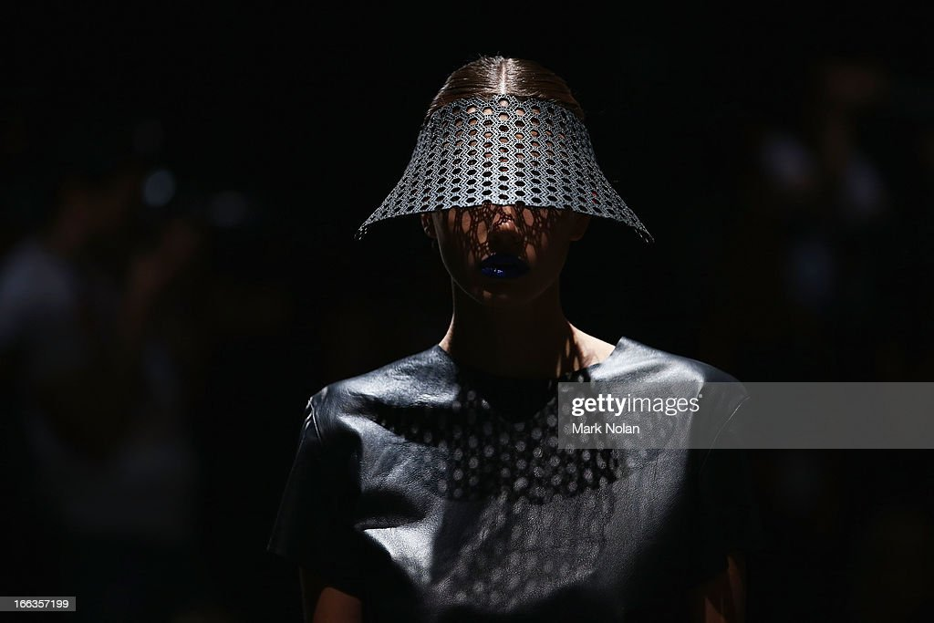 A model showcases designs on the runway at the Christina Exie show during Mercedes-Benz Fashion Week Australia Spring/Summer 2013/14 at Carriageworks on April 12, 2013 in Sydney, Australia.