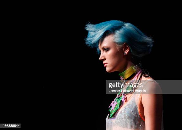 A model showcases designs on the runway at the Emma Mulholland show during MercedesBenz Fashion Week Australia Spring/Summer 2013/14 at Carriageworks...