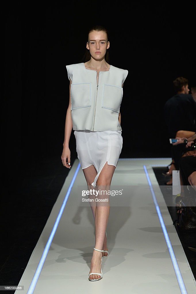 A model showcases designs on the runway at the Han show during Mercedes-Benz Fashion Week Australia Spring/Summer 2013/14 at Carriageworks on April 10, 2013 in Sydney, Australia.