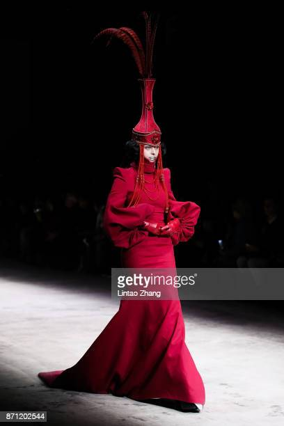 A model showcases designs on the runway at the Haute Couture Collection show by designer Hu Sheguang during the MercedesBenz China Fashion Week...