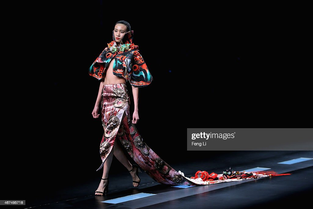 A model showcases designs on the runway at the Hempel Award 23rd China International Young Fashion Designers Contest during MercedesBenz China...