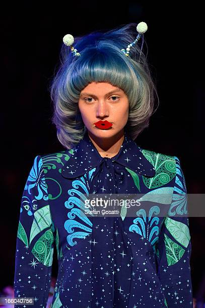 A model showcases designs on the runway at the Romance Was Born show during MercedesBenz Fashion Week Australia Spring/Summer 2013/14 at...
