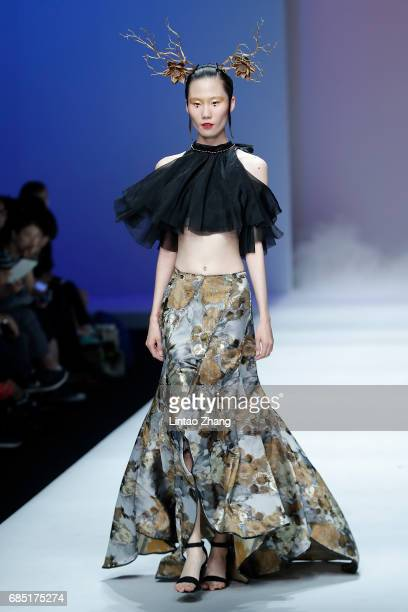 A model showcases designs on the runway at the Shanxi Fashion Engineering University Show during the day five of China Graduate Fashion Week at the...