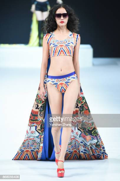 A model showcases designs on the runway at the TONGRENTANG by ELau Collection show during the MercedesBenz China Fashion Week Spring/Summer 2018...