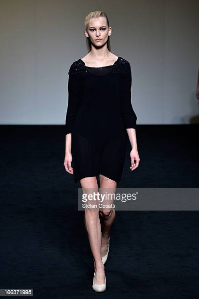 A model showcases designs on the runway at the Zambesi show during MercedesBenz Fashion Week Australia Spring/Summer 2013/14 at Carriageworks on...