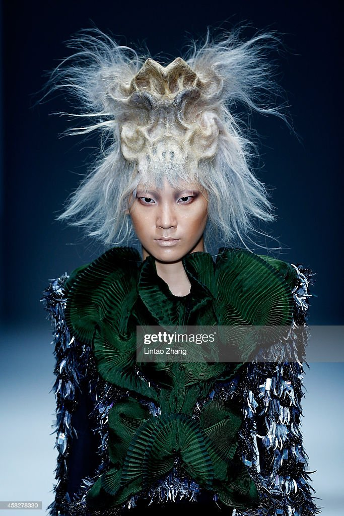 A model showcases designs on the runway at TONIGUY Hairstyling Trends Launch 2015 show during the MercedesBenz China Fashion Week Spring/Summer 2015...
