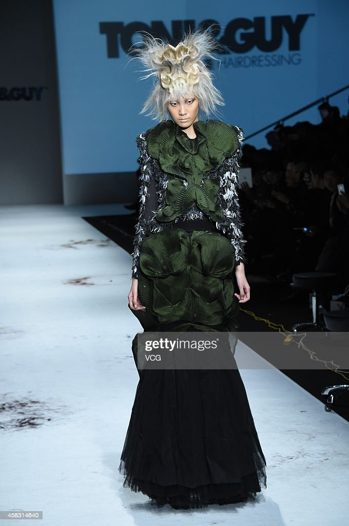 Model showcases designs on the runway at TONIGUY Hairstyling Trends Launch 2015 during the ninth day of the MercedesBenz China Fashion Week...