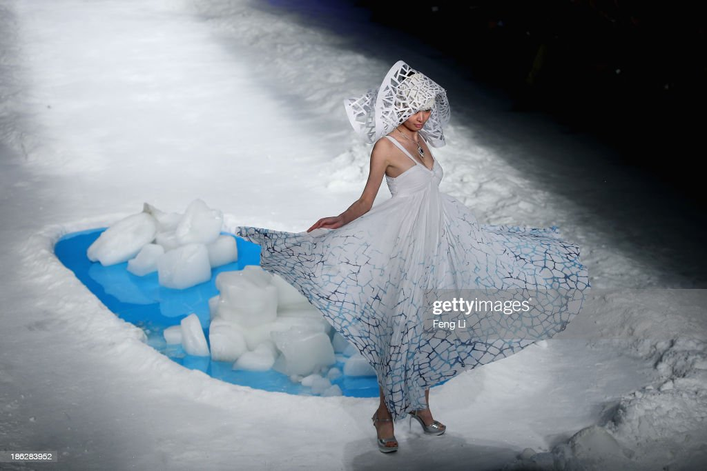 A model showcases designs on the runway at TORAY Liu Wei Collection show during Mercedes-Benz China Fashion Week Spring/Summer 2014 at 751 D-PARK Workshop on October 30, 2013 in Beijing, China.