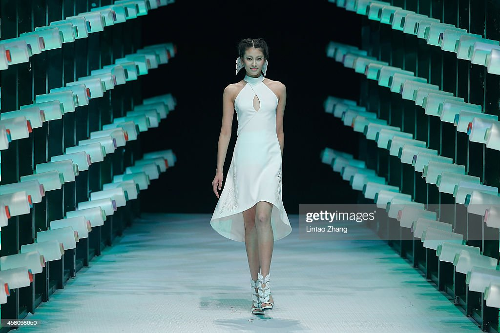 A model showcases designs on the runway at TORAY Liu Wei Collection show during day six of Mercedes-Benz China Fashion Week Spring/Summer 2015 at 751D.PARK Workshop on October 30, 2014 in Beijing, China.