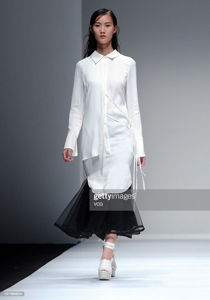 A model showcases designs on the runway at underoath show during the Shanghai Fashion Week 2015 Spring/Summer on October 20 2014 in Shanghai China