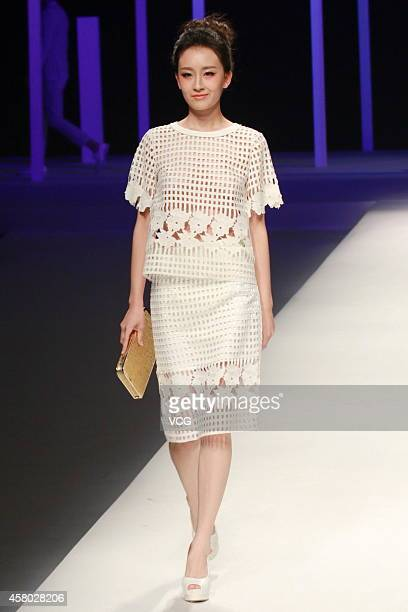 A model showcases designs on the runway at VISCAP Yuan Bing Collection show during the fourth day of the MercedesBenz China Fashion Week...