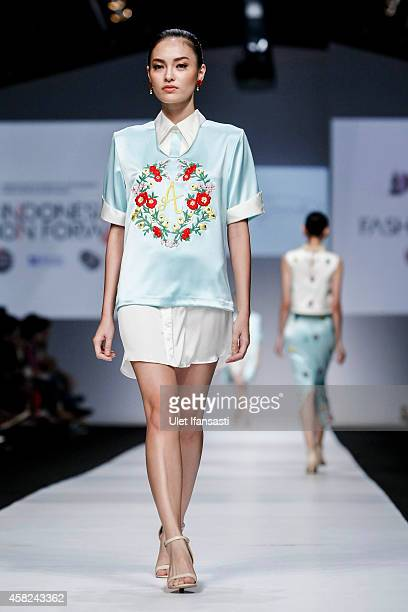A model showcases designs on the runway by Andhita Siswandi during the Jakarta Fashion Week 2015 at Senayan City on November 1 2014 in Jakarta...
